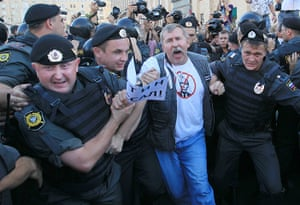 Pussy Riots: Russian policemen detain an opposition activists for Pussy Riots