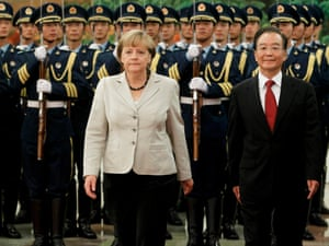 German chancellor Angela Merkel and Chinese Premier Wen Jiabao walk during a welcoming ceremony at the Great Hall of the People in Beijing, China, 30 August 2012.