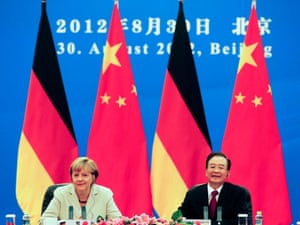 German Chancellor Angela Merkel, left, and Chinese Premier Wen Jiabao hold a bilateral talks inside the Great Hall of the People in Beijing Thursday, Aug. 30, 2012.
