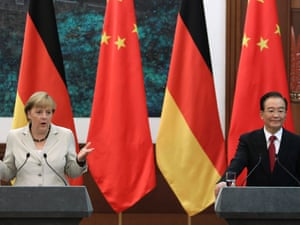 German Chancellor Angela Merkel (L) speaks next to China's Premier Wen Jiabao at a news conference at the Great Hall of the People in Beijing, August 30, 2012.