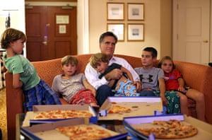 Republican convention: Mitt Romney sits in his hotel room with his grandchildren