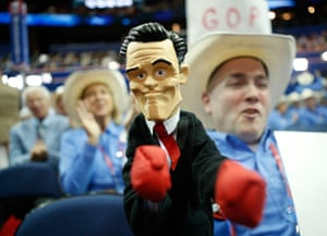 Republican convention: Texas delegate Patrick O'Daniel holds a fighting doll of Mitt Romney