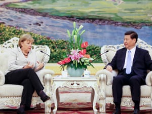 German Chancellor Angela Merkel,  left, talks with Chinese Vice President Xi Jinping,  right,  during their meeting at the Great Hall of the People in Beijing, China, Thursday, Aug. 30, 2012