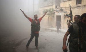 Free Syrian Army fighter gestures during fighting with Syrian government forces in the El Amreeyeh neighborhood of Syria's northwestern city of Aleppo today.