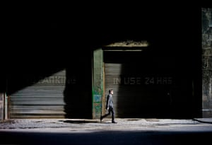 Your Pictures: Fade: Man walking in front of old building with peeling paint