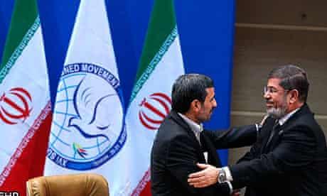 Mahmoud Ahmadinejad with Mohamed Morsi at Non-Aligned Movement summit