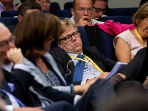 A journalist sleeps while another yawns while French President Francois Hollande and Spain's Prime Minister Mariano Rajoy give a joint news conference at the Moncloa Palace in Madrid Thursday Aug. 30, 2012