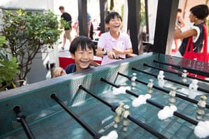 Venice architecture: Some kids have fun playing table football outside the Australian pavilion
