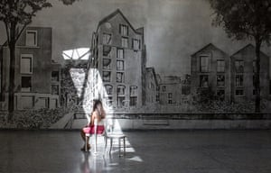 Venice architecture: A visitor sits in a shard of light in the Swiss Pavillion