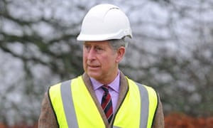 Prince Charles views work on a property bought by the Duchy of Cornwall