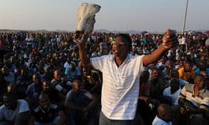 Workers protest at the Lonmin Marikana platinum mine