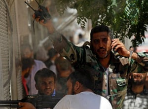 Aleppo: A Free Syrian Army fighter gestures after his friend was shot