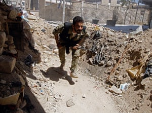 Aleppo: A Free Syrian Army fighter runs for cover