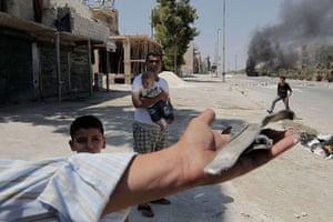 Aleppo: A Syrian youth shows shrapnel pieces