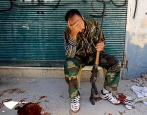 Aleppo: A Free Syrian Army fighter reacts after his friend was sho