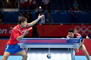 Table tennis: Hyok Bong Kim serves to a forcussed Sangeun Oh