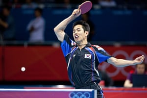 Table tennis: Saehyuk Joo of South Korea returns to Song Man Jang of North Korea