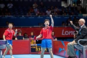 Table tennis: North Korea's SM Jang & SN Kim celebrate