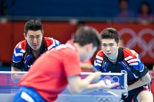 Table tennis: South Korea's S Oh & S Ryu. Korea look determined to return this serve