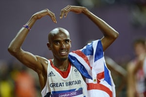 Mo Farah: Mo celebrates with his arms raised in a Mo sign after winning the race
