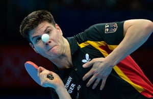 London 2012 Table Tennis: Dimitrij Ovtcharov eyes the ball before returning a shot to Michael Maze