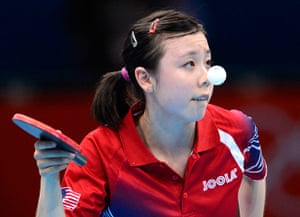 London 2012 Table Tennis: Ariel Hsing, 16 of the USA serves to No. 2 seed Xiaoxia Li