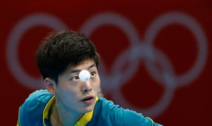 London 2012 Table Tennis: Justin Han serves against Mawussi Agbetoglo during their table tennis match