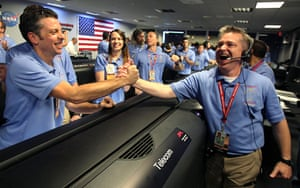 Curiosity Rover lands: MSL Flight director Keith Comeaux, right, celebrates