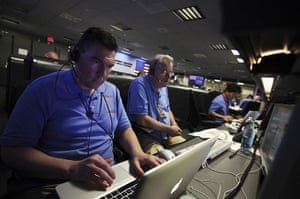 Curiosity Rover lands: Engineers work inside the Spaceflight Operations Facility before landing