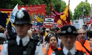 Demonstrators walk through central Londo