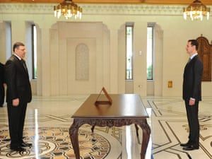 """Riyad Hijab is sworn in as new Syrian Prime Minister by Syrian President Bashar al-Assad in Damascus on 26 June 2012. He defected to Jordan today denouncing Assad's """"murderous"""" government. Photo: handout/Sana/Reuters."""