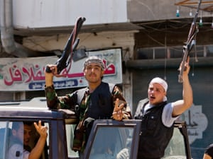 Rebel fighters of the Free Syrian Army hold up their rifles in the northern restive Syrian city of Aleppo, on 3 August. Photo: AFP/Getty Images/Veday Xhysmshiti