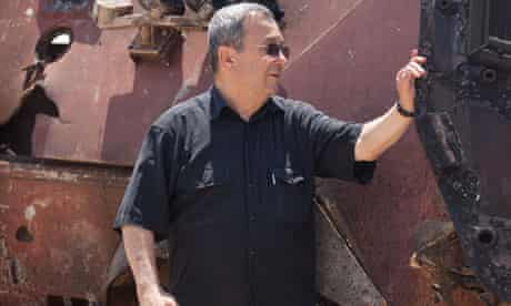 Israeli minister Ehud Barak inspects destroyed Egyptian vehicle driven by militants into Israel