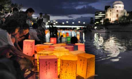 People release paper lanterns on the Motoyasu river to remember victims of the Hiroshima atomic bomb