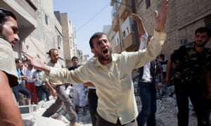 A Syrian man shouts as residents gather
