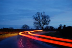 Your Pictures: Getaways: Blurred light of a car on road