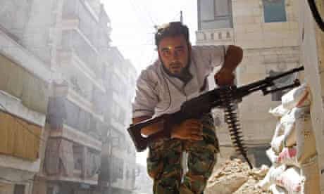 A Syrian rebel fighter takes cover during clashes in central Aleppo