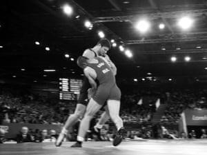 Romania's Alin Alexuc-Ciurariu (L) and Bulgaria's Elis Guri wrestle in the Greco-Roman wrestling at Excel