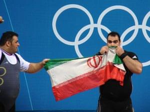 Behdad Salimikordasiabi celebrated winning gold in the men's +105kg weightlifting
