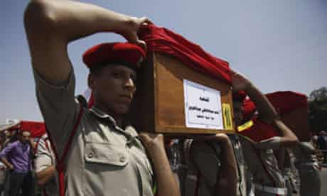 The funeral parade for 16 soldiers killed by militants who attacked a checkpoint in Sinai