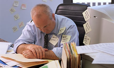 Overworked Businessman Wearing Sticky Notes