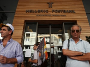 Postbank workers protest against government privatization plans outside bank's headquarters during a 24-hour strike in Athens, Wednesday, Aug. 8, 2012.