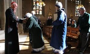 Cardinal Sean Brady with worshippers