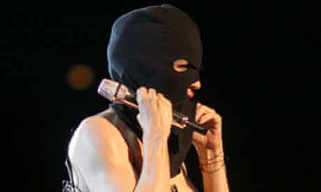 Madonna performs wearing Pussy Riot's trademark balaclava during her Moscow concert