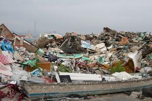 Soma, Japan: Damaged fishing boats and debris lay mixed together