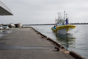 Soma, Japan: Early morning and the first of 5 fishing boats arrives