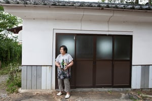 Soma, Japan: Chieko Sasaki, 66, stands outside the storehouse in which she makes sake