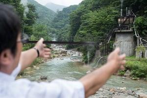 Soma, Japan: Kazuya Ikeda explains the future location of a planned geothermal plant