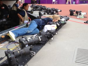 There's a fair amount of hardware here: Lucy Nicholson of Reuters sets up one of her many remotes in the Olympic stadium this evening.