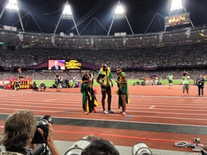 Usain Bolt and his fellow Jamaican teammates Yohan Blake and Warren Weir  celebrate after taking gold, silver and bronze in the men's 200m final